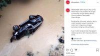 Mobil Pajero terjun bebas di jembatan Gunung Medan, Dharmasraya, Minggu (3/1/2021).